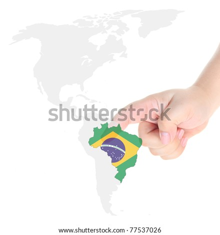 Finger touch on a future innovative transparent touch screen Brazil map and flag