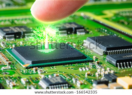 finger touching circuit board and glow pcb tree - stock photo