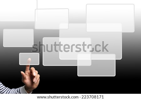 Finger touching digital screen - stock photo