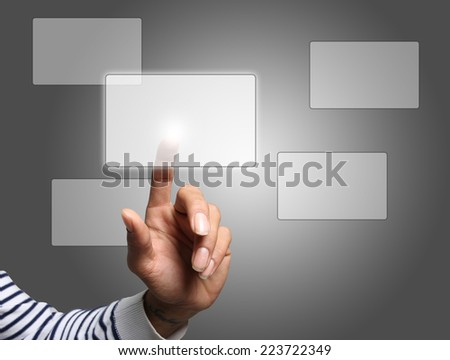 Finger touching transparant - stock photo