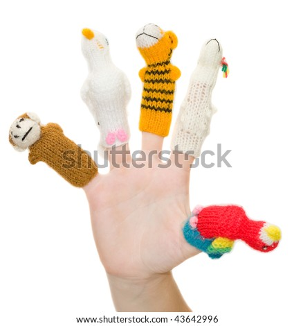 Finger-type theatre with puppets. Female hand wearing five finger puppets; monkey, bird, tiger, lamb, parrot. Animal show. Finger theatre - stock photo