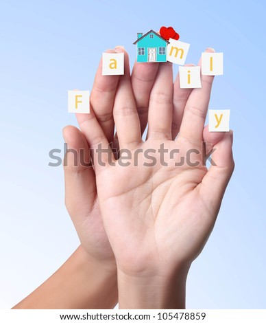 finger with the paper and word Family on a blue background - stock photo