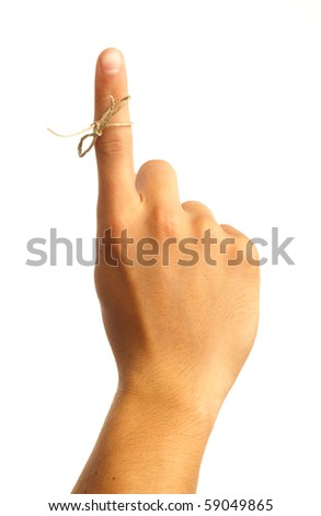 finger with tied bow - stock photo