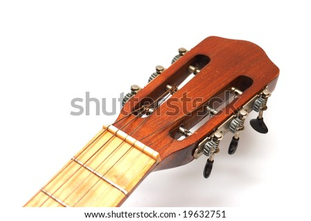 Fingerboard of old guitar on white - stock photo