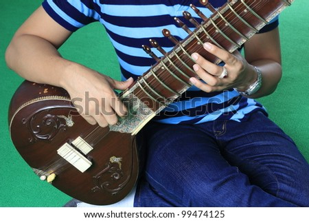 Fingering posture for play the sitar - stock photo