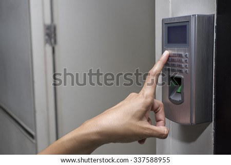 fingerprint and access control in a office building - stock photo