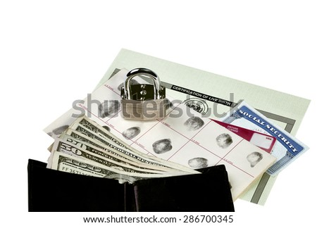 Fingerprint card, driver's license, social security card, wallet with currency and birth certificate isolated on white with locked padlock sitting on documents - stock photo