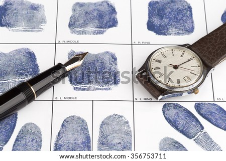 Fingerprint card with fountain pen and old watch - stock photo