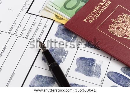 Fingerprint card with russian travel passport - stock photo