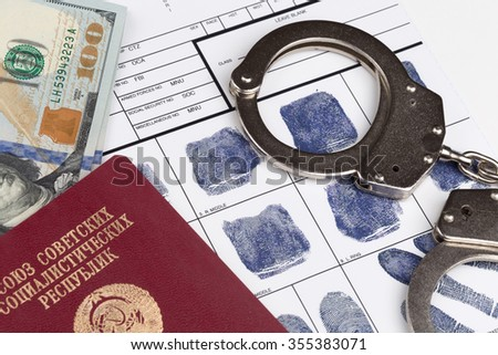 Fingerprint card with russian travel passport of Soviet Union and handcuffs - stock photo
