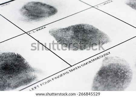 Fingerprint on police fingerprint card. - stock photo