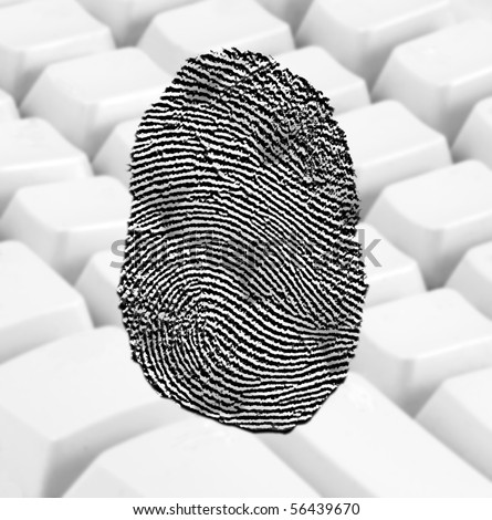 Fingerprint over background of a white keyboard - stock photo