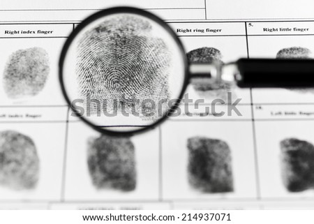 Fingerprints on original fingerprint form. - stock photo