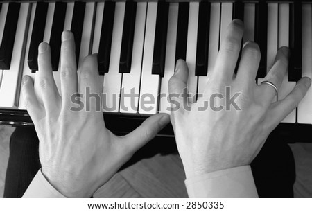 fingers and piano - stock photo