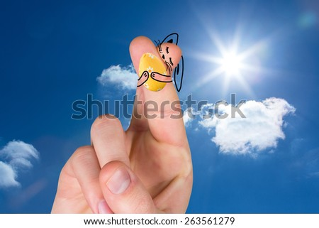 Fingers as easter bunny against bright blue sky with clouds - stock photo