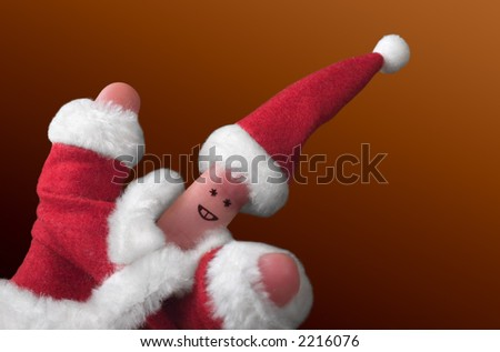 Fingers dressed in Santa-Claus red-white costumes