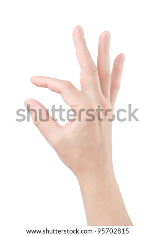Fingers hold small object - stock photo
