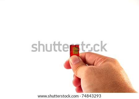 Fingers holding a mobile phone GSM SIM Card. Isolated on white background - stock photo