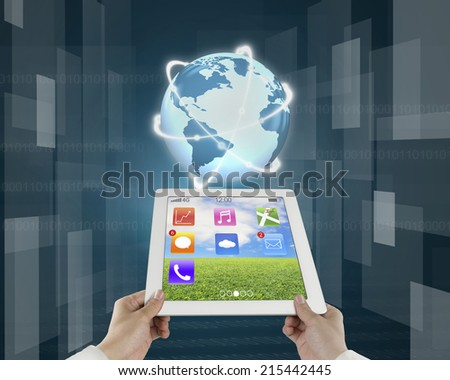 fingers holding light pad with planet and tech digital background