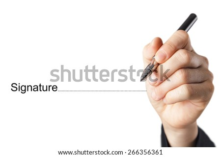 Fingers holding pen writing signature