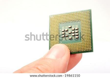 Fingers holding processor unit over white - stock photo