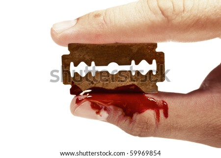 fingers keep the old rusty razor with blood on a white background - stock photo