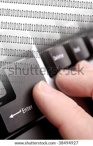 Fingers on enter key of computer keyboard. Binary code. - stock photo