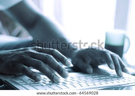 fingers on the laptop keyboard - stock photo