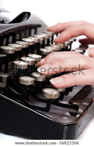 fingers on vintage typing machine on white - stock photo