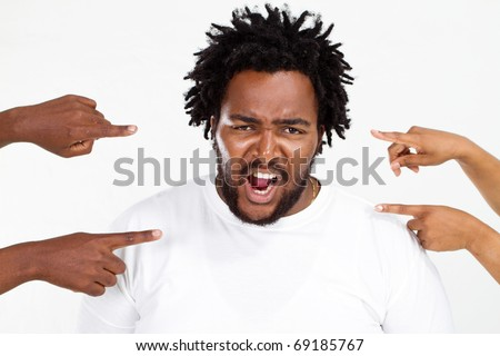 fingers pointing at angry overweight african american man - stock photo