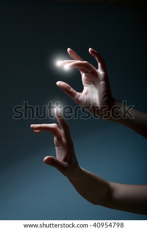fingers pressing a touchscreen and white spots appear - stock photo