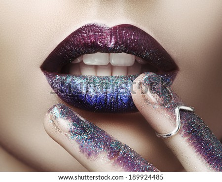 Fingers touch lips - stock photo