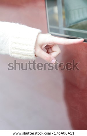 Fingertips of Japanese woman window-shopping - stock photo