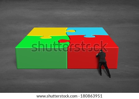Finish assembling 3d puzzles on concrete ground - stock photo