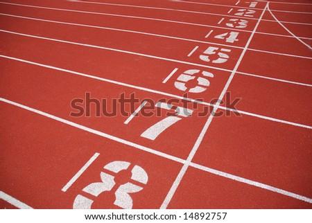 finish line of running tracks - stock photo