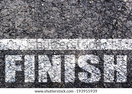 Finish line on asphalt - stock photo