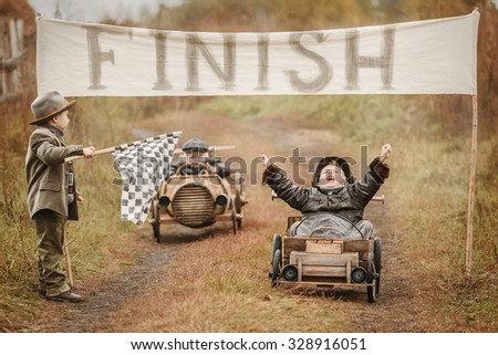 Finish of competition between the two little boys racers on homemade wooden car. Retouch for retro