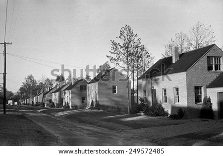 Finished brick homes in the Newport News Housing project for African Americans, Oct. 1937. The homes would be sold on long term payment plan. Photo by John Vachon. - stock photo