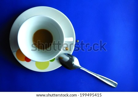 Finished Coffee in a ceramic cup Photo of a finished or drank coffee in a ceramic cup and saucer and a teaspoon - stock photo
