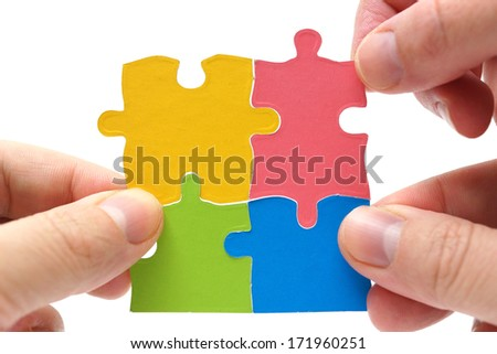 Finished project concept. Puzzles isolated on white background - stock photo
