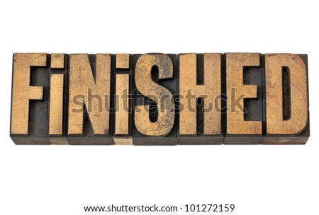 finished - success concept - isolated word in vintage letterpress wood type - stock photo