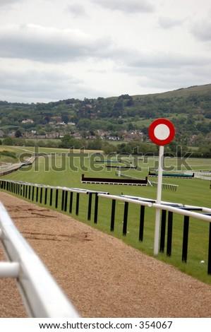 Finishing line at cheltenham race course - stock photo
