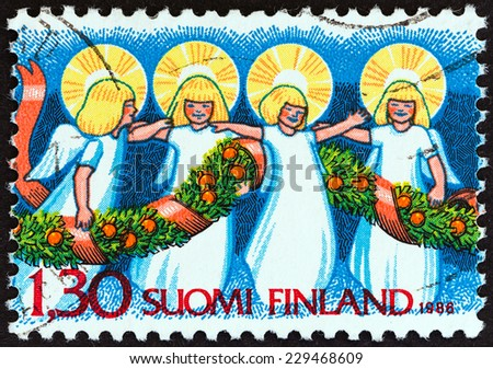 """FINLAND - CIRCA 1986: A stamp printed in Finland from the """"Christmas """" issue shows  Angels and Garland, circa 1986. - stock photo"""