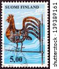 "FINLAND - CIRCA 1975: A stamp printed in Finland from the ""Traditional Finnish Arts"" issue shows Kirvu Weather Vane, circa 1975. - stock photo"
