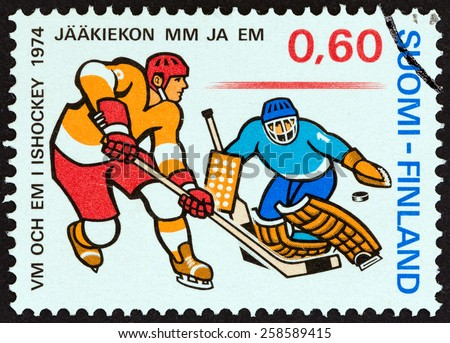 """FINLAND - CIRCA 1974: A stamp printed in Finland from the """"World and European Ice Hockey Championships """" issue shows Ice Hockey players, circa 1974. - stock photo"""