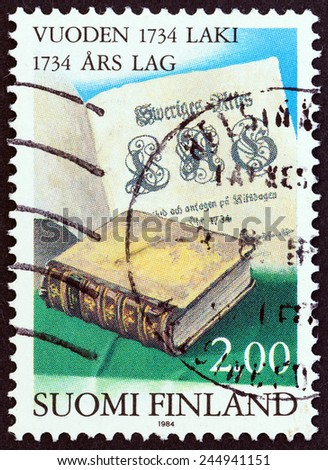 FINLAND - CIRCA 1984: A stamp printed in Finland issued for the 250th anniversary of 1734 Common Law shows Statute Book and Title Page, circa 1984.  - stock photo