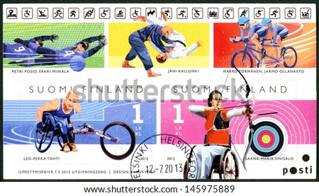 FINLAND - CIRCA 2012: A stamp printed in Finland shows Champions in disabled sports, wheelchair racer Leo-Pekka Tahti and para-archer Sanna-Maria Sinisalo, series Summer Paralympic Games, circa 2012 - stock photo