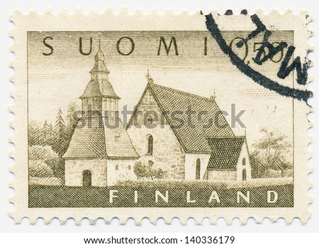 FINLAND - CIRCA 1963: A stamp printed in Finland shows old church in Lammi, circa 1963