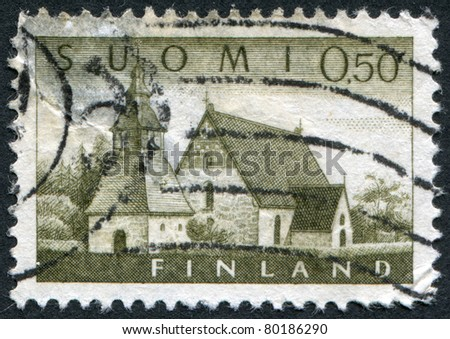 FINLAND-CIRCA 1963: A stamp printed in the Finland, shows a Church at Lammi, circa 1963