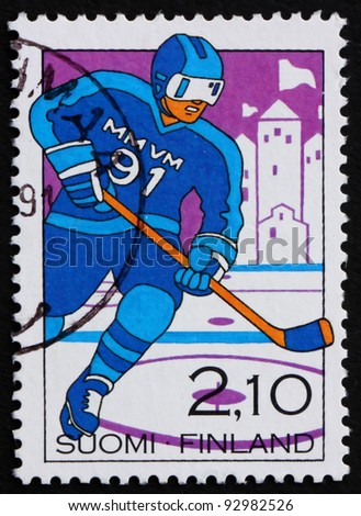 FINLAND - CIRCA 1991: a stamp printed in the Finland shows Man Playing Hockey, World Hockey Championships, Turku, circa 1991